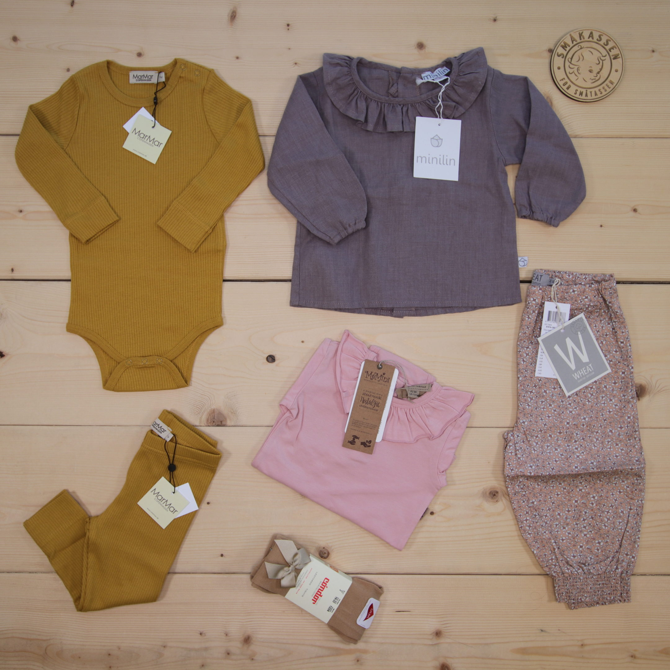 This is a 125 GBP* Småkassen that we prepared for a girl  in the styles cute and cool in size 80