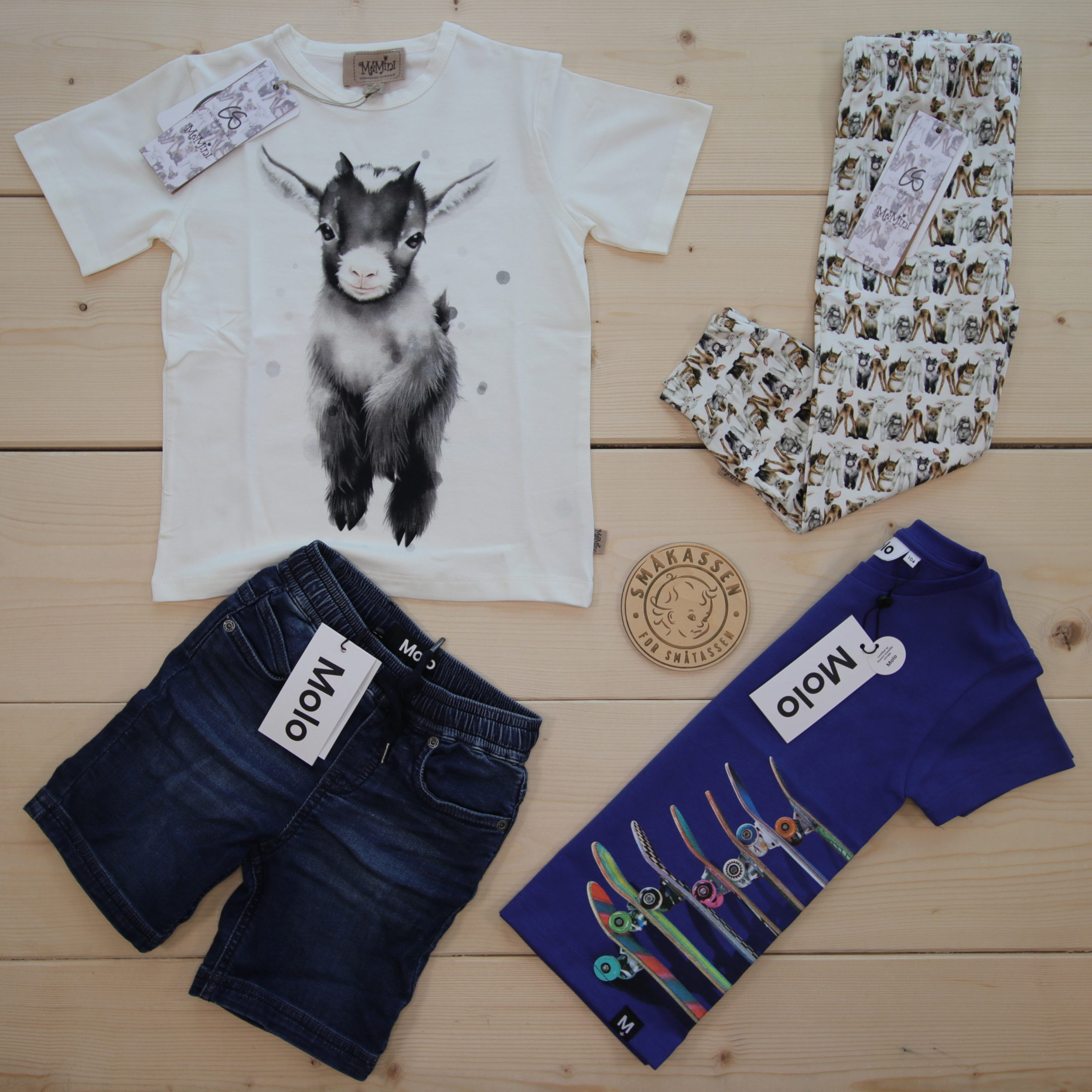 This is a 125 GBP* Småkassen that we prepared for a boy  in the styles cute and cool in size 104