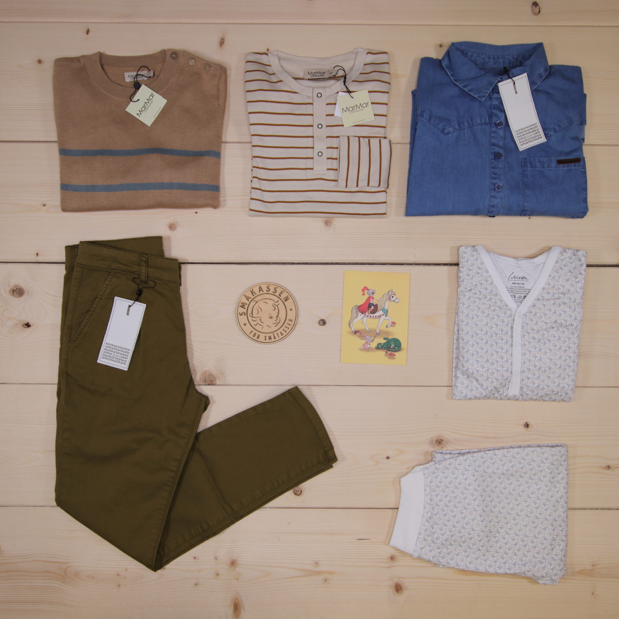 This is a 208 GBP* Småkassen that we prepared for a boy  in the styles cute and cool in size 140