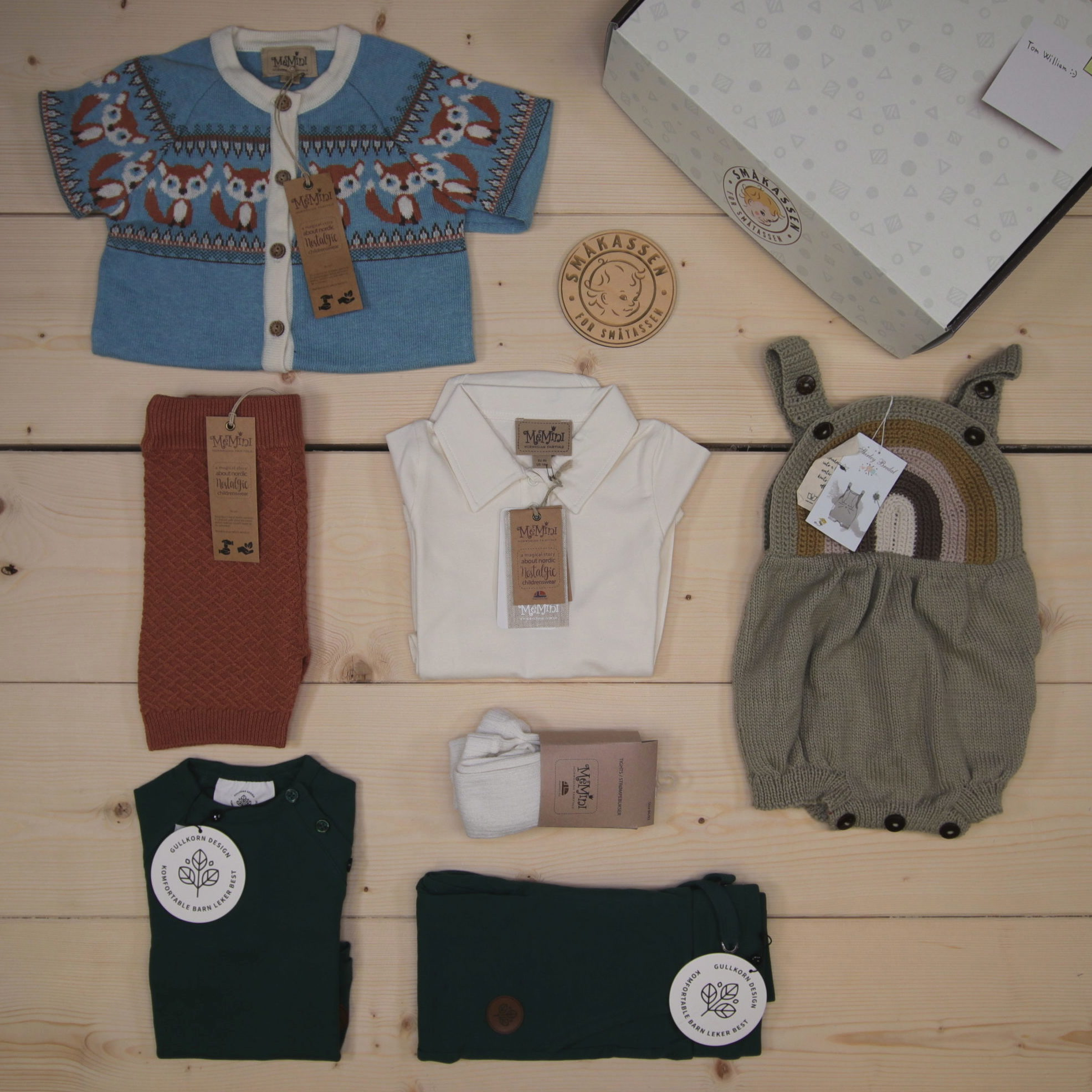 This is a 2500 NOK* Småkassen that we prepared for a boy  in the styles cute and cool in size 86