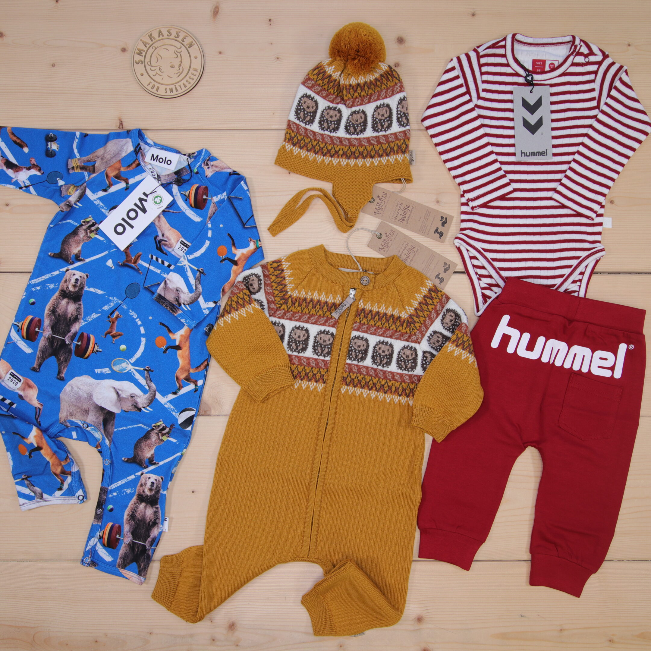 This is a 2000 NOK* Småkassen that we prepared for a boy  in the styles cool, cute, and colorful in size 68